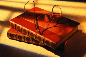 Eyeglasses atop Books