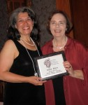 Kathy Eliscu accepting plaque from Gail Collins.