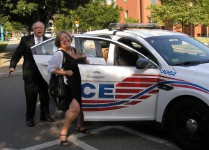 Howard University police pick up NSNC members Bob Haught and Joani Foster ... to give them a ride back to the student union, June 28, 2014.