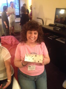 Michele 'Wojo' Wojciechowski holds an empty Berger Cookie box in the Hospitality Suite of the 2014 Conference in Washington, D.C.